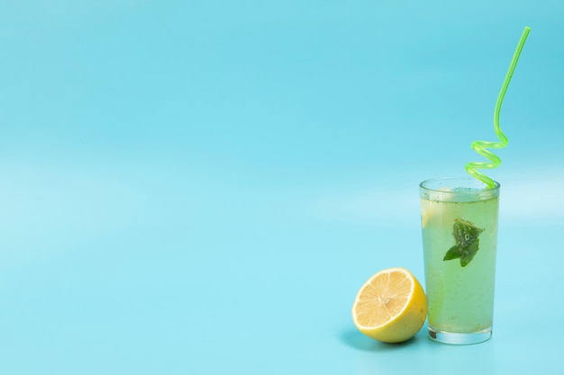 Delicious lemonade on blue backgound with copy space Free Photo