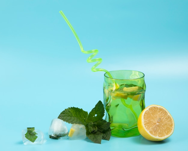 Delicious lemonade with mint leaves on blue background Free Photo