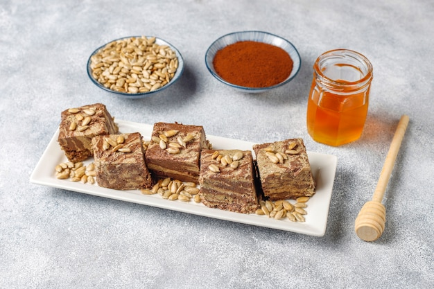 Delicious marble halva with sunflower seeds, cocoa powder and honey, top view Free Photo