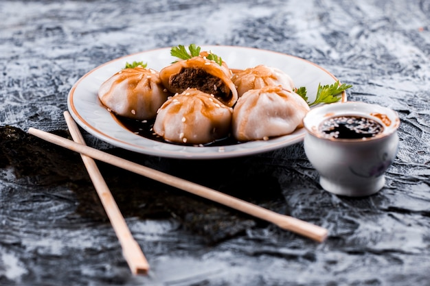 Delicious meat dumplings and sauce front view Free Photo