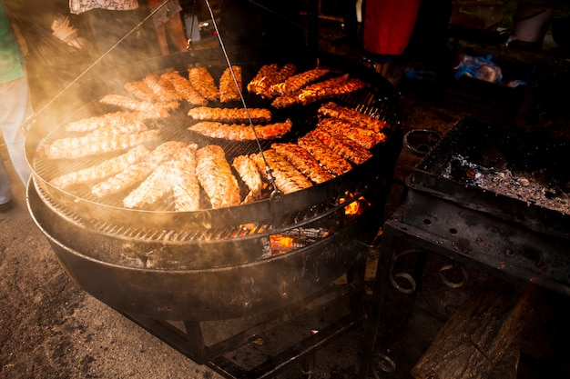 Delicious meat rolls on grill high view Free Photo