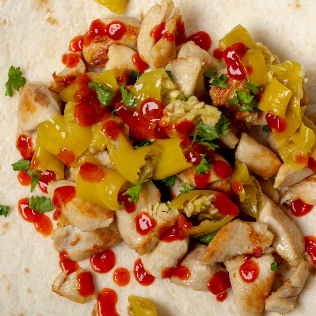 Delicious mexican dish on tortilla Free Photo