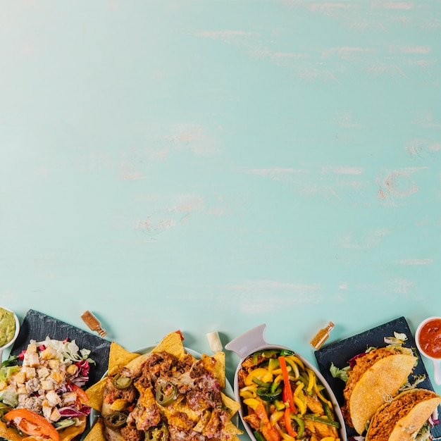 Delicious mexican food on blue background Photo | Free ...
