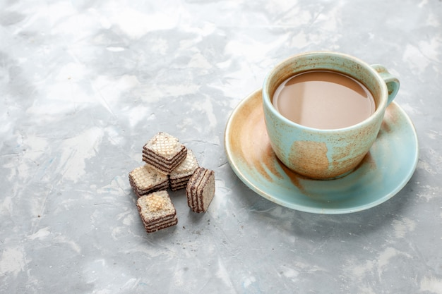 Delicious milk coffee with chocolate waffles on light desk, chocolate cookie sweet sugar Free Photo
