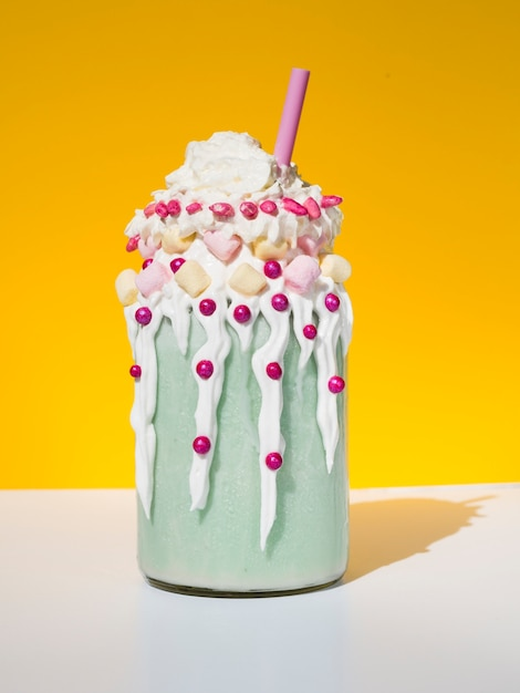 Delicious milkshake with yellow background Free Photo