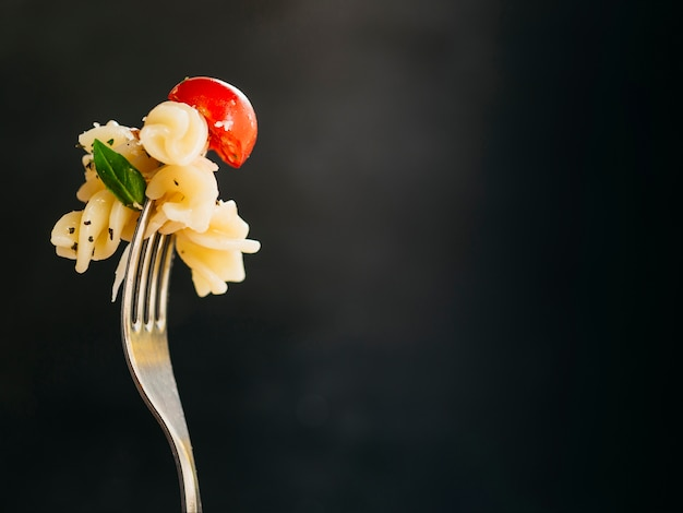 Delicious pasta on a fork Free Photo