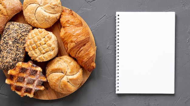 Delicious pastry products and a notebook Free Photo
