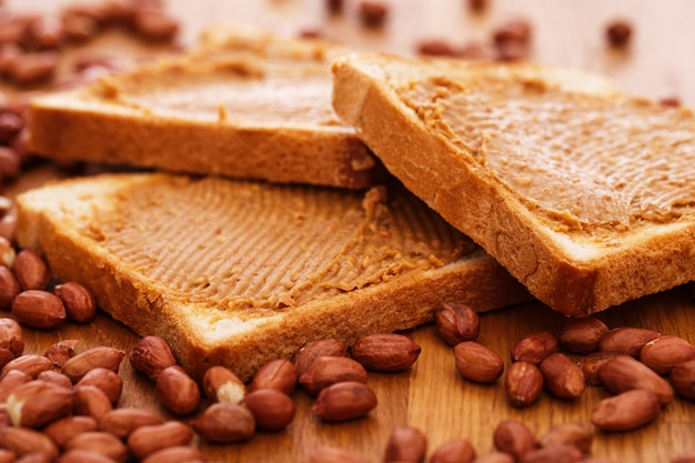 Delicious peanut butter on a toast Free Photo