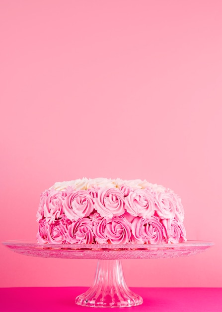 Delicious pink cake with roses Free Photo
