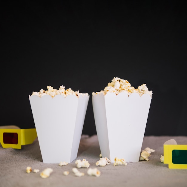Delicious popcorn boxes on the table Free Photo