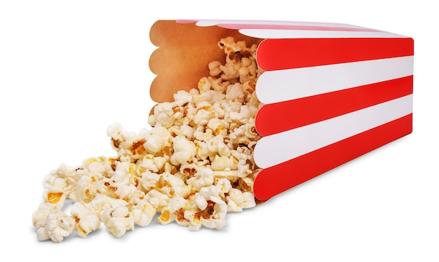 Delicious popcorn and overturned red striped paper popcorn bucket isolated on white background. Premium Photo