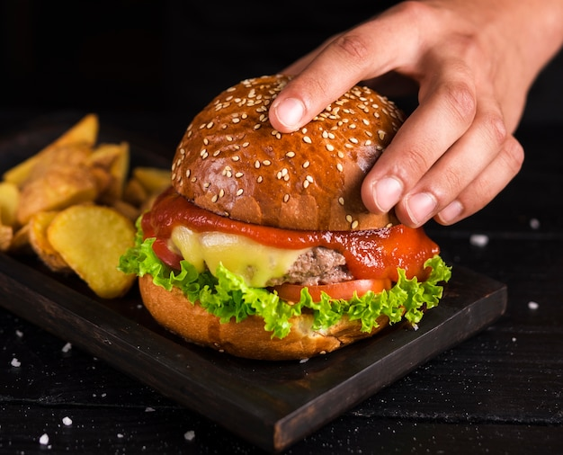 Delicious ready to be served beef burger Free Photo