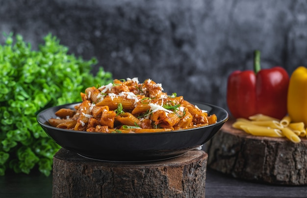 Delicious red sauce pasta with cheese on top Premium Photo