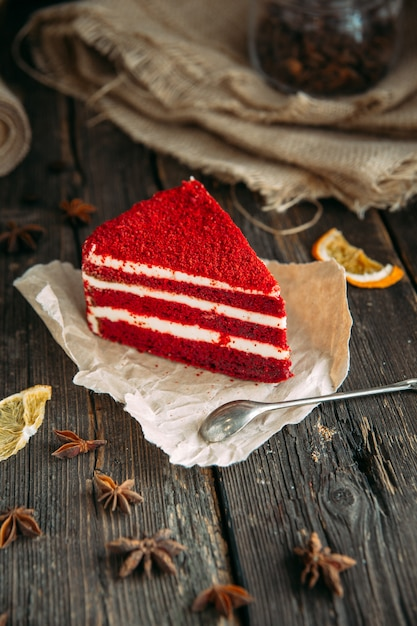 Delicious red velvet cake on a wooden table with spoon Premium Photo