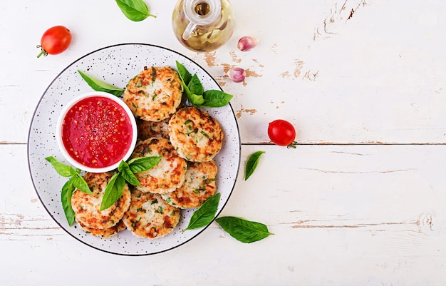 Delicious rice and chicken meat patties with garlic tomato sauce Free Photo