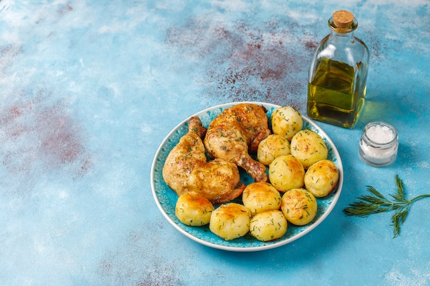 Delicious roasted young potatoes with dill and chicken,top view Free Photo