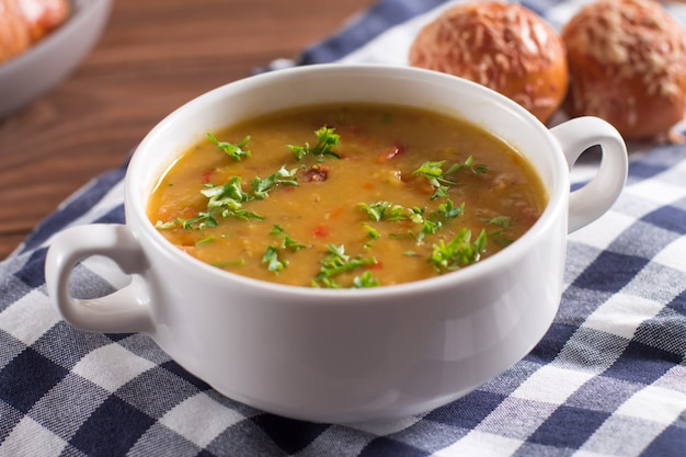 Delicious rustic soup with vegetables, lentils and peas Premium Photo