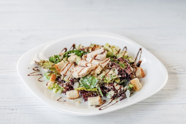 Delicious salad with cucumber and chicken and lettuce Premium Photo