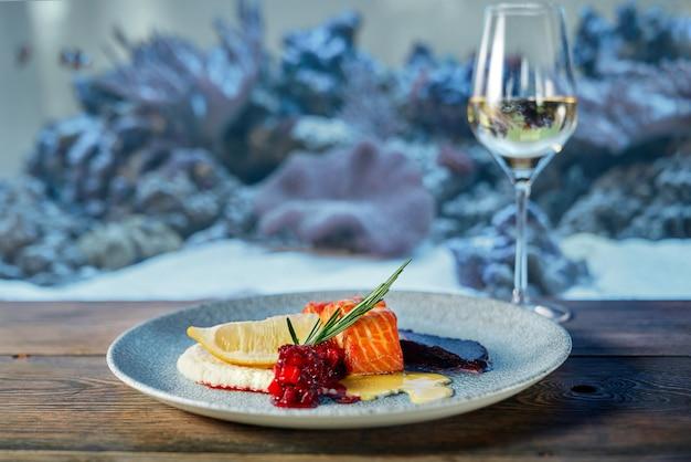 Delicious salmon steak with sauces in restaurant. Premium Photo