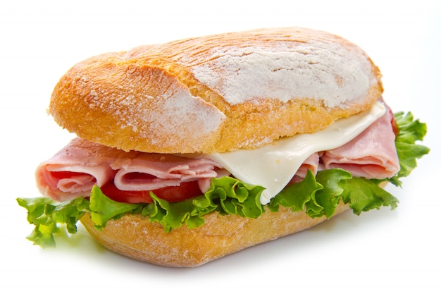 A delicious sandwich whith ham and salad Premium Photo
