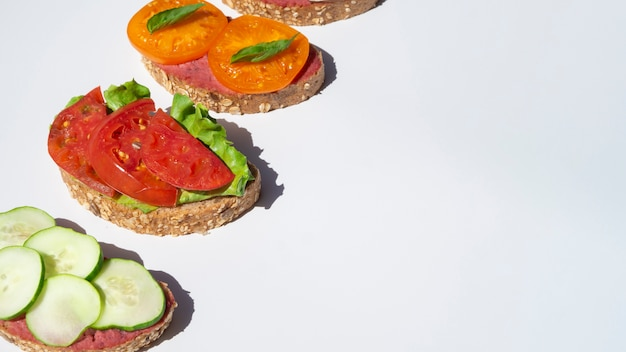 Delicious sandwiches with tomatoes and cucumbers Free Photo