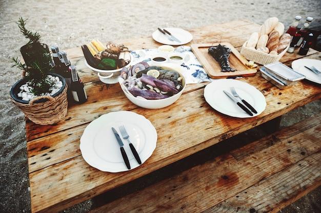 Delicious sea food wooden table bench shore concept Free Photo