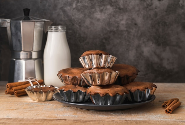 Delicious set of muffins with milk Free Photo