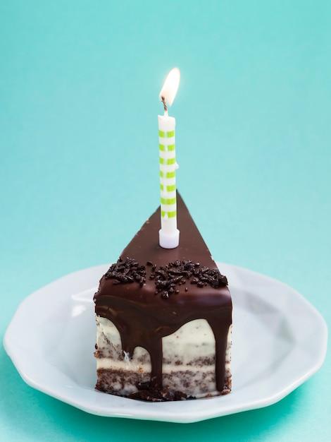 Delicious slice of chocolate birthday cake Free Photo