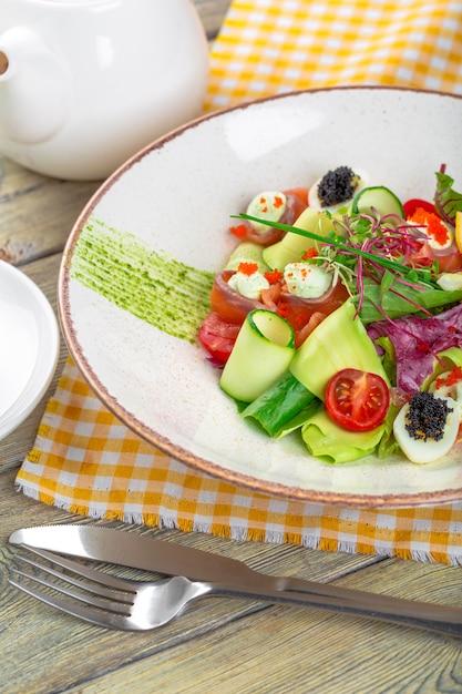 A delicious smoked salmon with salad Premium Photo