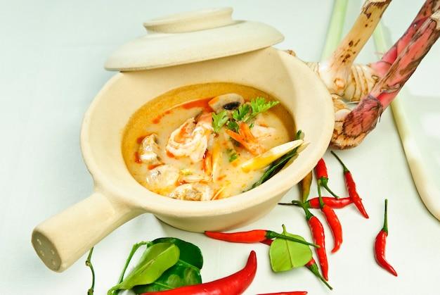 Delicious spicy coconut cream soup with chicken Premium Photo