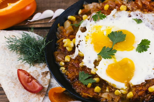 Delicious spicy mexican food with fried eggs Free Photo