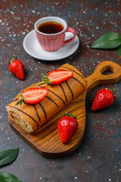Delicious strawberry cake roll with fresh strawberries,top view Free Photo