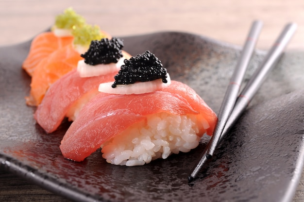 Delicious sushi plate with chopsticks Free Photo