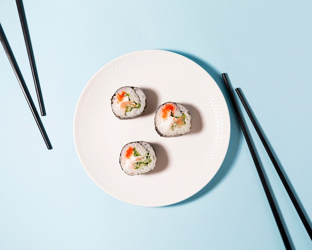 Delicious sushi rolls on plate Free Photo