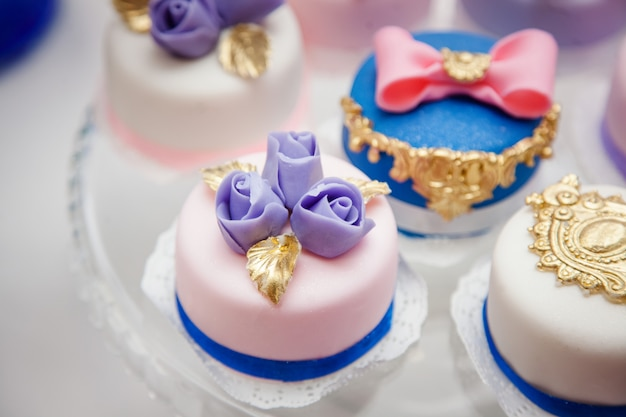 Delicious sweets on wedding candy buffet with desserts Premium Photo