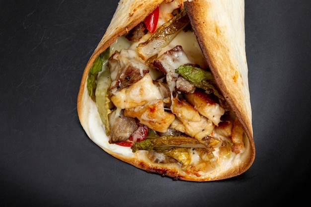 Delicious traditional taco with meat and vegetables Free Photo