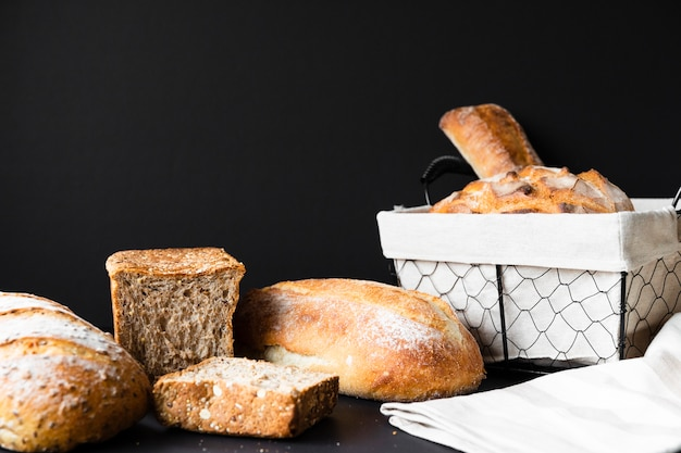 Delicious types of bread and basket long shot Free Photo