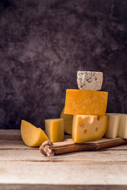 Delicious variety of cheese on the table Free Photo