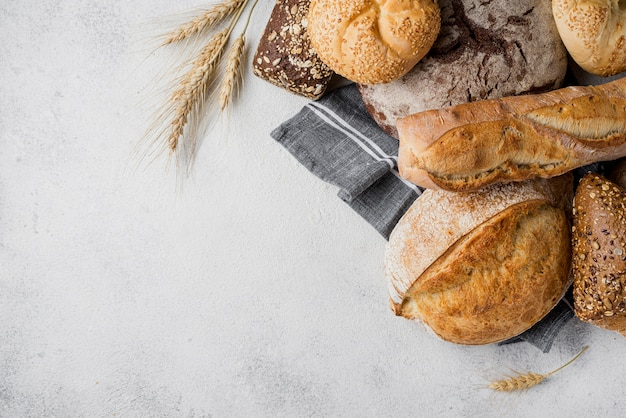 Delicious white and whole-grain bread with wheat Free Photo