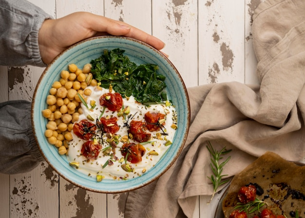 Delicious yougurt meal with chickpeas and dried tomatoes Free Photo