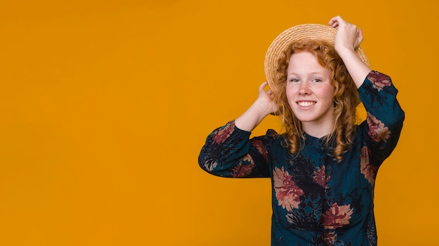 Delighted curly woman in studio with colored background Free Photo
