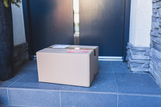 Delivered carton box on porch Free Photo