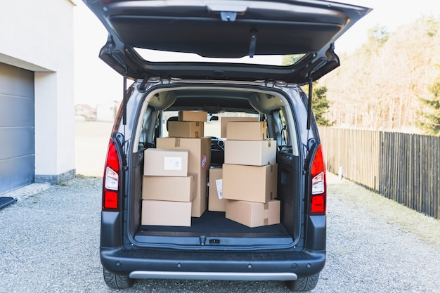 Delivery car trunk with boxes Free Photo