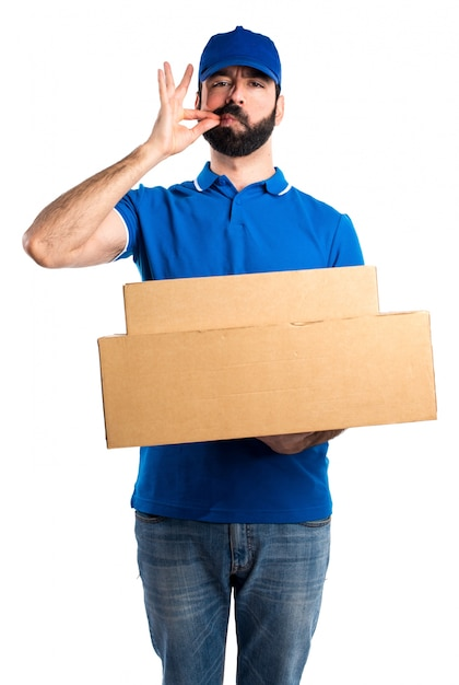 delivery man making silence gesture photo free download