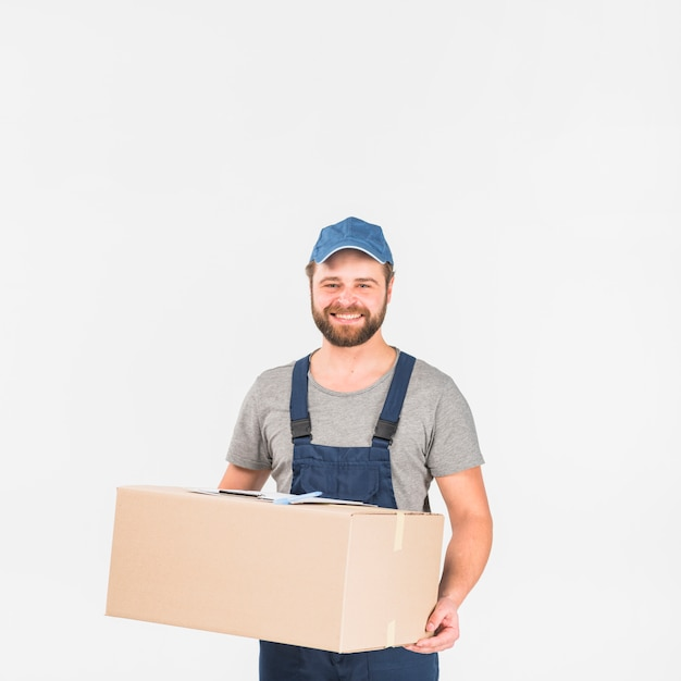 Delivery man standing with big box Free Photo