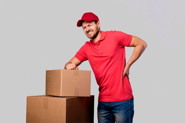 Delivery man tired from carrying Free Photo