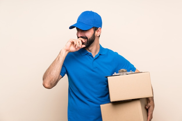 Delivery man with beard over smiling a lot Premium Photo