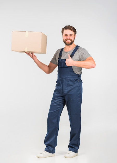 Delivery man with big box showing thumb up Free Photo