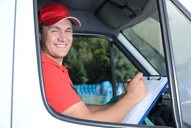 Delivery of a package through a delivery service. Premium Photo