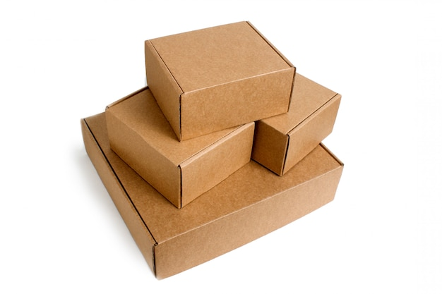 Delivery. pile of stacked cardboard boxes isolated on white. Premium Photo
